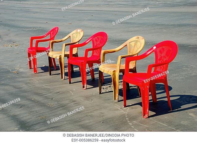 Plastic chairs at Bakkhali beach ; Calcutta Kolkata ; West Bengal ; India