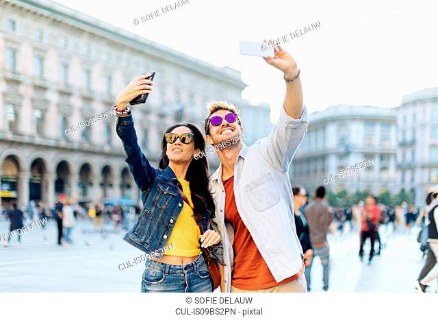 Couple taking selfie, Piazza del Duomo, Milan, Italy