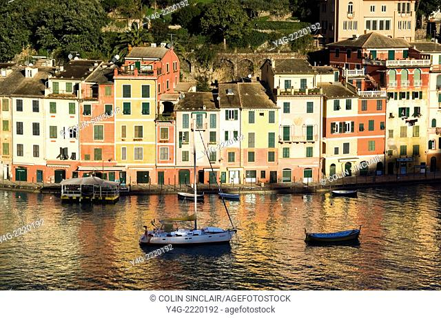 Portofino, Ligurian Coast, Italy, Port, Boats, Colourful homes, Reflections in Sea, Backdrop hillsides with pines and beautiful houses, Horizontal, Winter