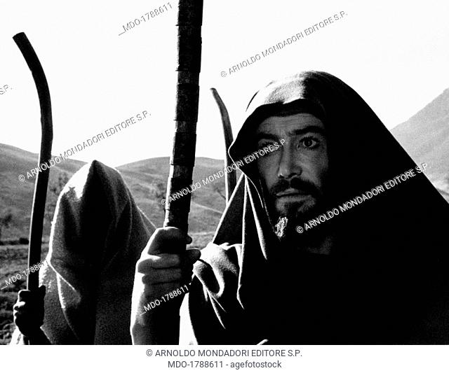 Irish actor Peter O'Toole leaned against a stick playing the Three Angels in the film The Bible In the Beginning. 1966