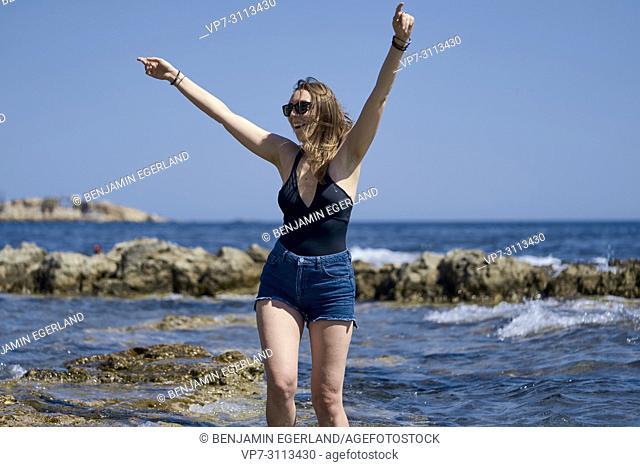woman dancing at seaside. Crete, Greece