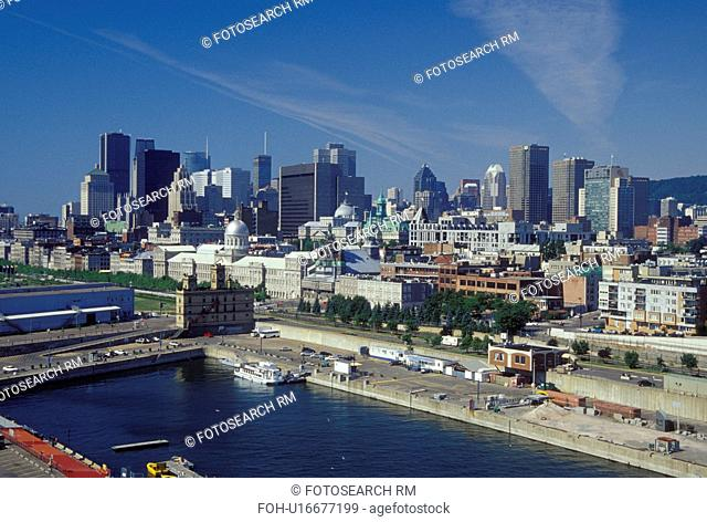 Montreal, Canada, Quebec, Vieux Port along the St. Lawrence River (Fleuve Saint-Laurent). Skyline of downtown Montreal