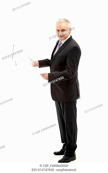 Businessman in a suit holding a plan