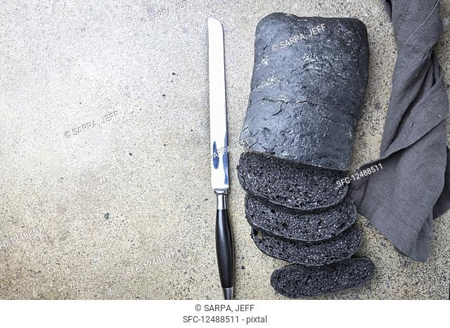Sliced black bread colored with squid ink