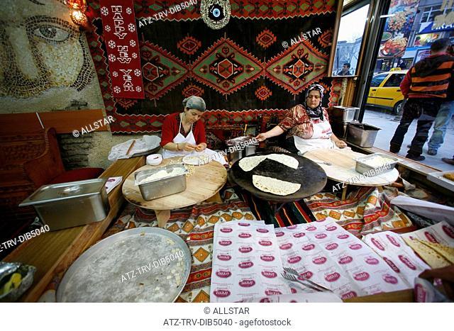 WOMEN MAKE BREAD NEAR GRAND BAZAAR; BAZAAR QUARTER, ISTANBUL, TURKEY; 13/02/2007
