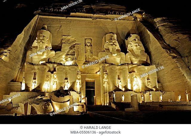 Pharaoh Ramses II, three sitting statues, monumental, in front of big rock temple, Abu Simbel, evening lighting, mystical, impressive, Pharaoh's time
