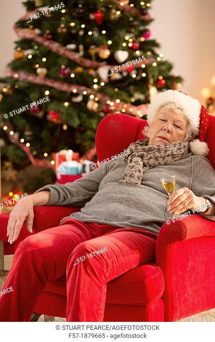 Senior woman having a catnap at Christmas time