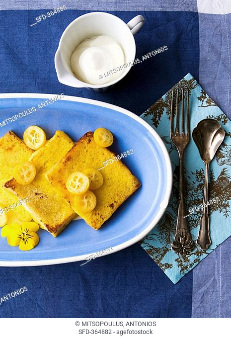 French toast with kumquats and whipped cream