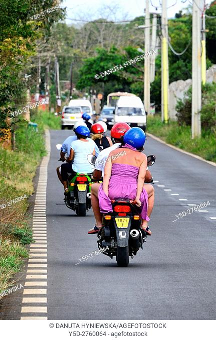mopeds are very popular way of transportation in Mauritius, here traffic on B29 road from capital - Port Louis to Tombeau Bay, Mauritius, Africa
