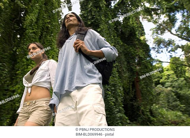 Low angle view of couple in forest