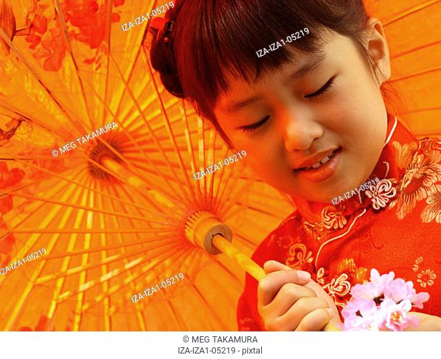 Close-up of a girl holding a parasol