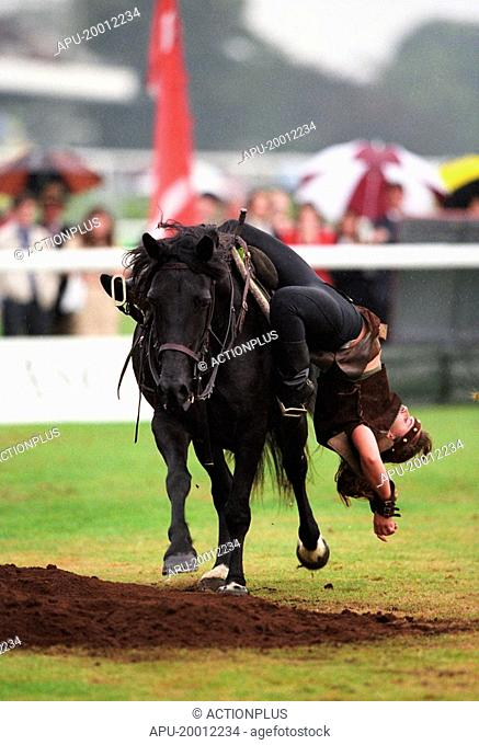 Trick horse rider turns over her saddle