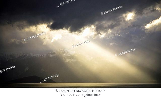 New Zealand, Southland, Fiordland National Park  Dramatic light as a storm clears from the moutain peaks surrounding Lake Te Anau