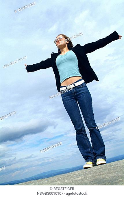 woman standing on a rock, symbolic for freedom