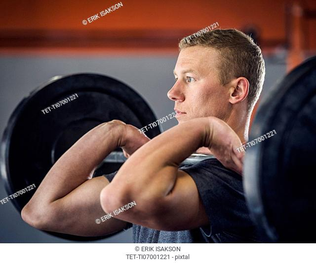 Young man weight lifting