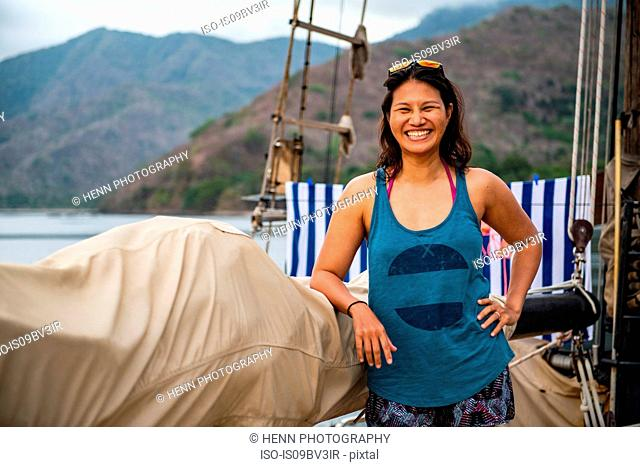 Female tourist smiling on sailboat, portrait, Komodo Island, East Nusa Tenggara, Indonesia