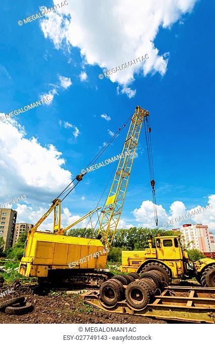 Mobile caterpillar crane on a background of blue sky