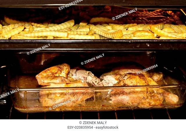 fresh chicken and french fries in oven