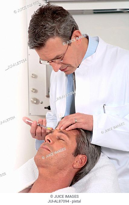 Man receiving anti-aging injection in face