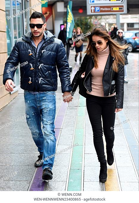 Loved-up Strictly Come Dancing stars Georgia May Foote and Giovanni Pernice are seen smiling while heading to the shops before heading to the Barclaycard Arena...