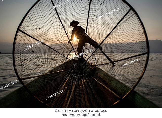 Silhouette of a Inle Lake Fisherman at work, Nyaungshwe, Shan State, Myanmar