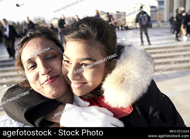 mother and daughter enjoying embrace. Paris, France