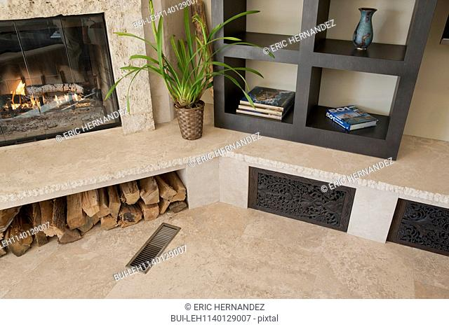Close-up of lit fireplace and built in shelf; Dana Point; California; USA