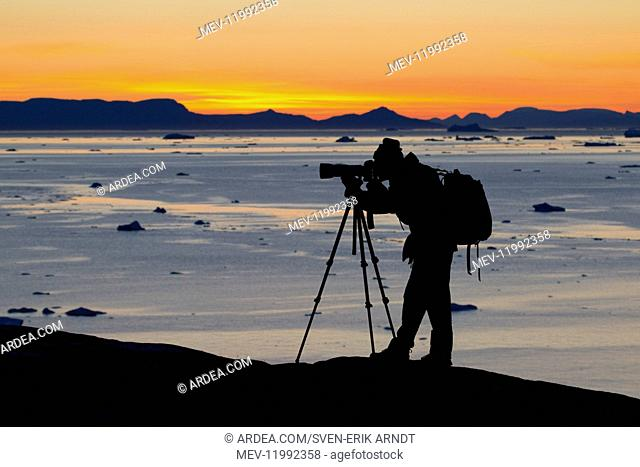 Tourist looking at the Icefjord - Disco Bay - Greenland