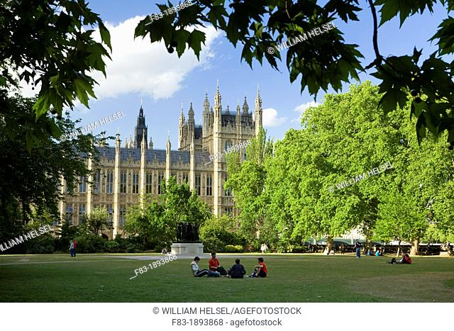 Victoria Tower Gardens and Houses of Parliament, Westminster, London, England, people relaxing on the lawn, May