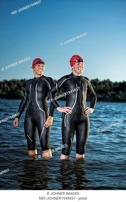 Women in wetsuit in sea, Sweden