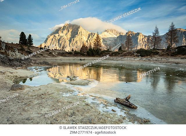Autumn dawn at frozen lake Limides, Dolomites, Italy