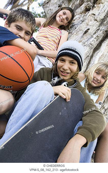Portrait of a teenage boy and his friends smiling