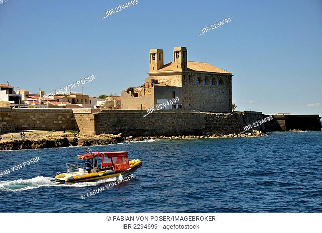 Boat in the harbour of the Island of Tabarca, church Iglesia de San Pedro at back, Isla de Tabarca, Costa Blanca, Spain, Europe