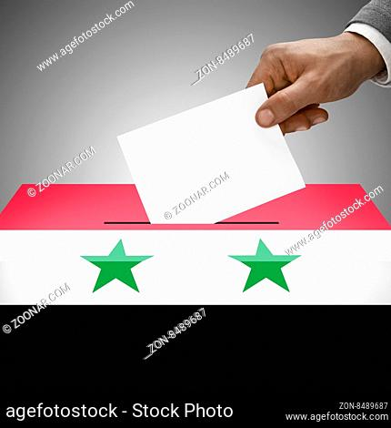 Ballot box painted into national flag colors - Syria