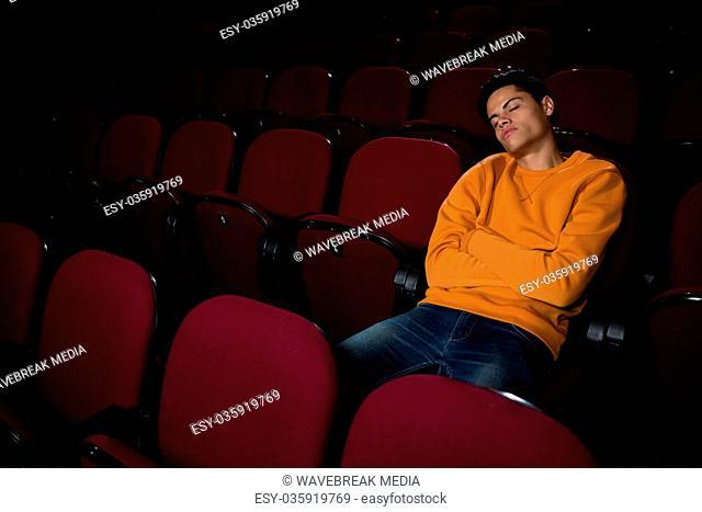 Man sleeping in the movie theatre