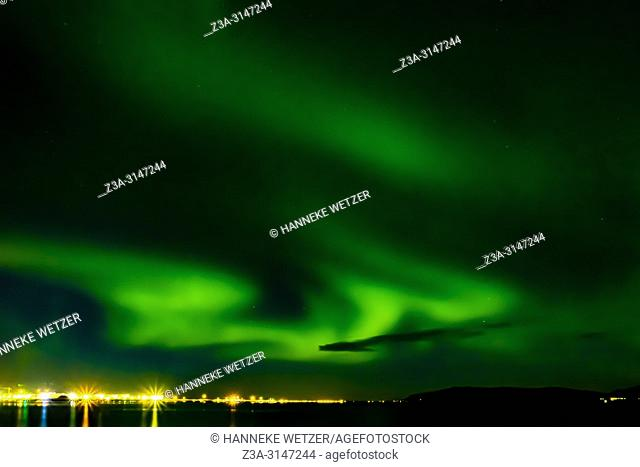 Skyline of Reykjavik at night with view on the Aurora Borealis, Iceland
