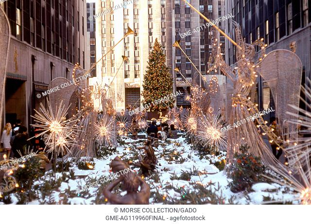 View of the Christmas angel decorations lining the Rockefeller Center Promenade from Fifth Avenue toward the ice skating rink, December, 1969