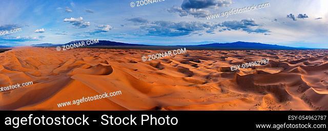 Aerial panorama view of the sand dunes Hongoryn Els in Gobi Desert at sunset, Mongolia
