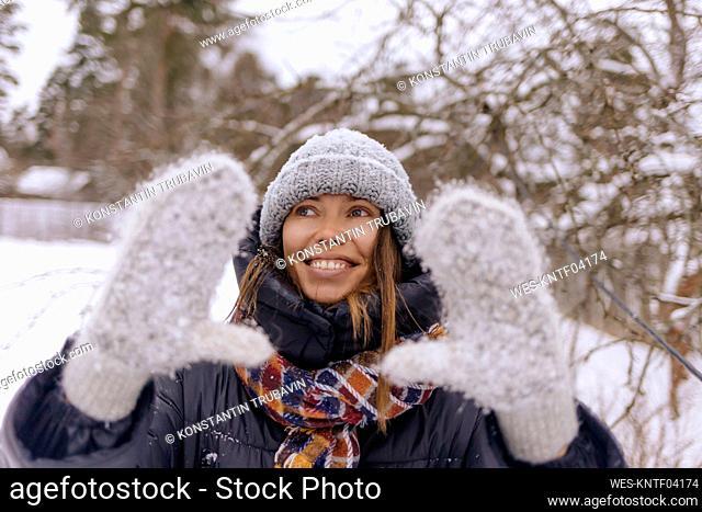 Portrait of happy woman in winter