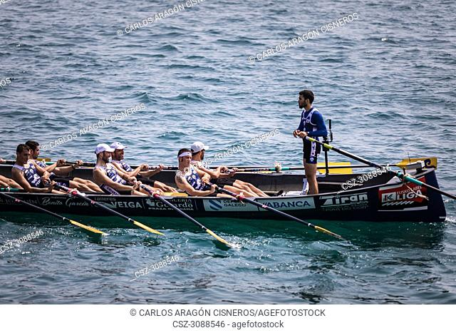 CASTRO URDIALES, SPAIN - JULY 15, 2018: Competition of boats, regata of trainera, Tiran Pereira boat in action in the VI Bandera CaixaBank competition