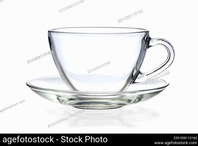 Empty glass cup and saucer isolated on a white background