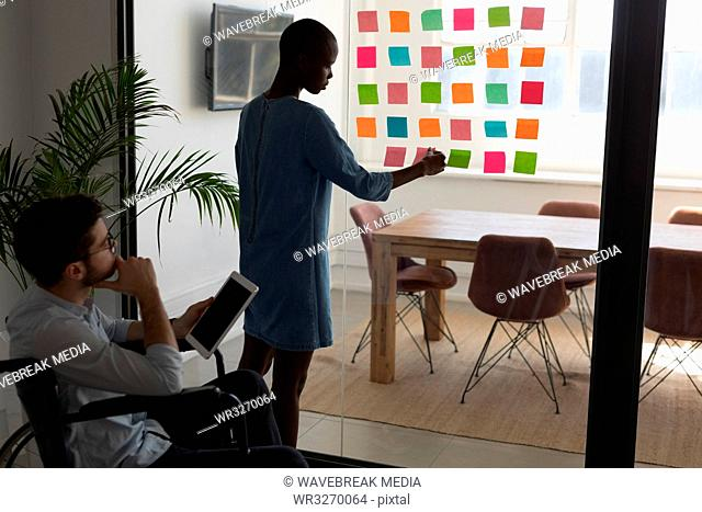 Executives working on sticky notes