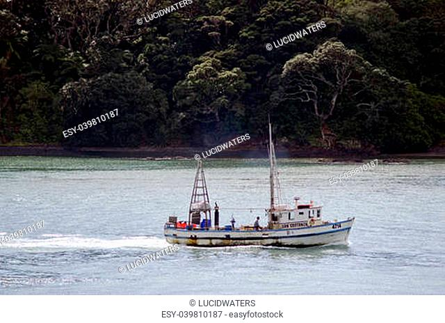 MANGONUI, NZ - JULY 25:Fishing boat enters Mangonui port on July 25 2013.NZ exclusive economic zone covers 4.1 million km2