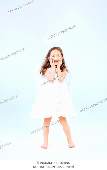 Angel child girl with pure white wings