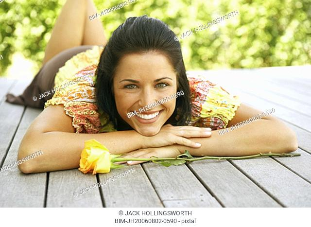 Young woman laying on deck