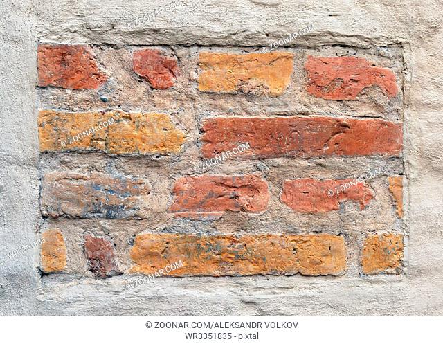 Banner of old vintage bricks as an element of plastered wall
