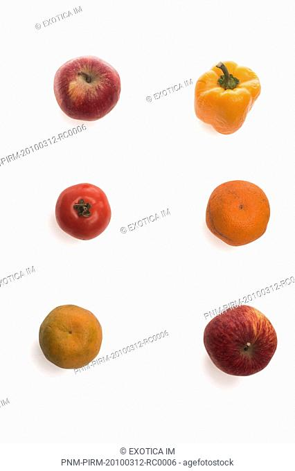 Arrangement of fruits and vegetables on white background