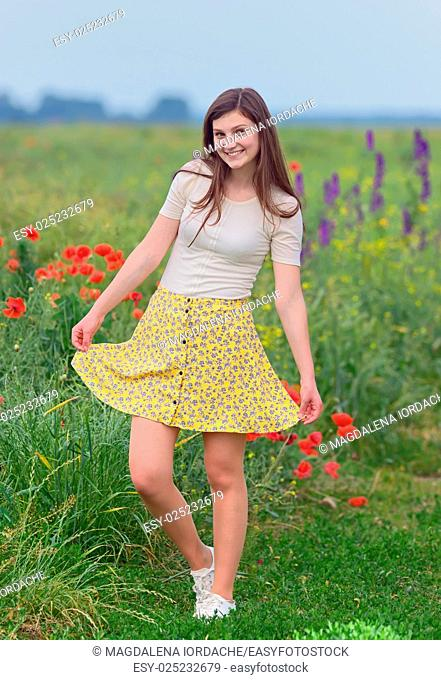 Smiling young girl on summer field