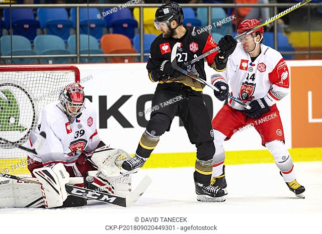 From left hockey players BRANDON MAXWELL, goalie of Hradec and LOIC LAMPERIER of Rouen in action during the Ice hockey Champions League matches group F...