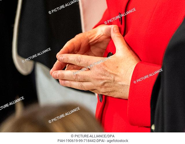 """19 June 2019, Saxony, Dresden: Federal Chancellor Angela Merkel (CDU) spreads her hands at the conference """"""""Morals & Machines 2019 - Can Artificial Intelligence..."""